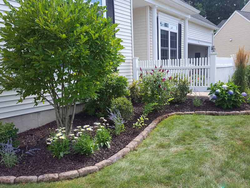 Encore Landscaping - stone edging around front planting bed - Steve N - After